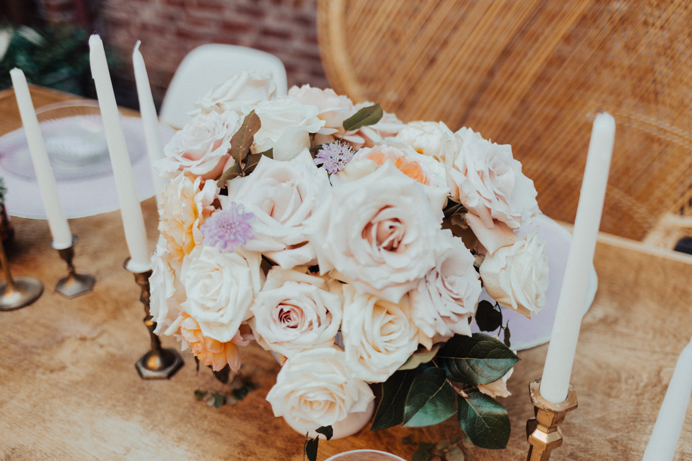 roses and candles on boho wedding table