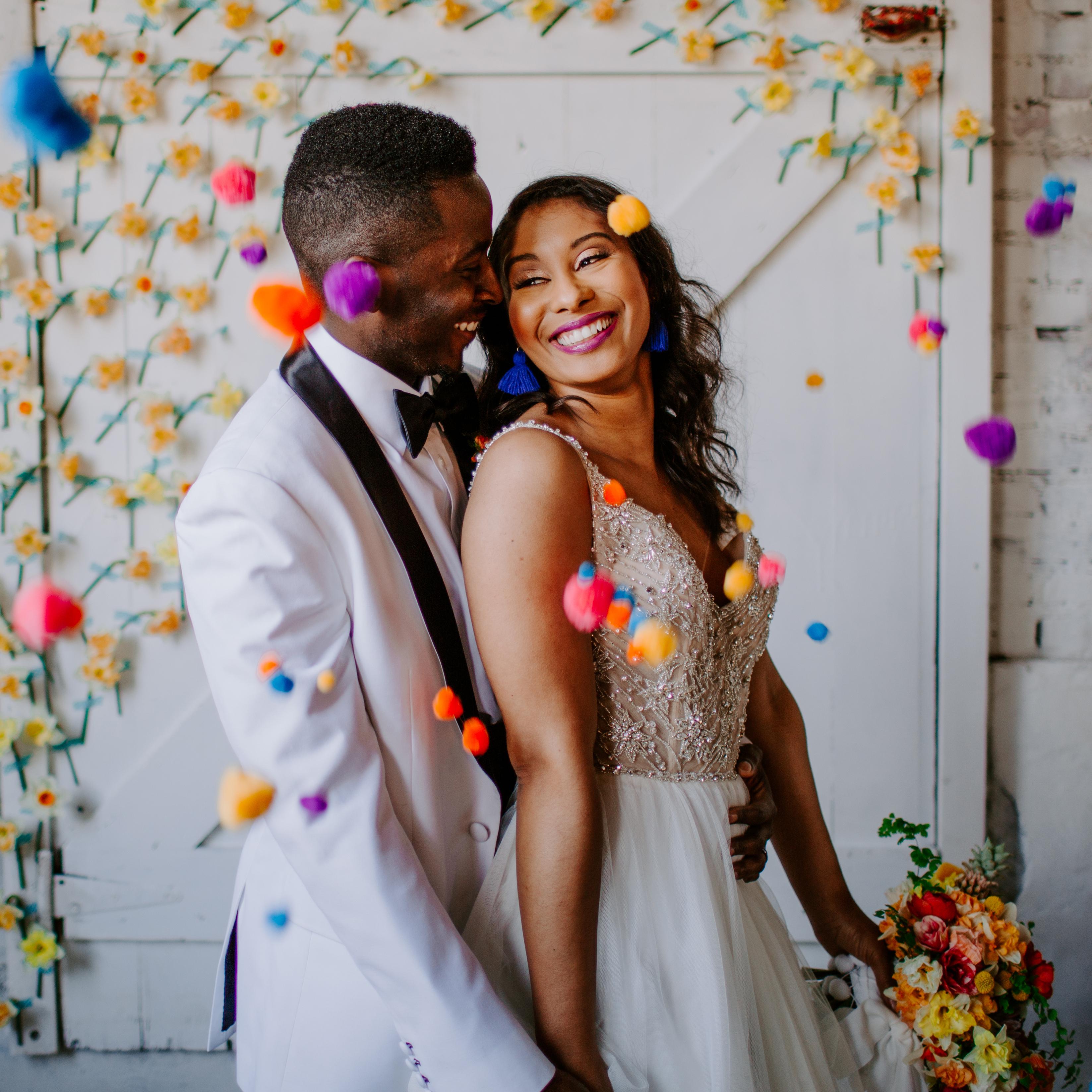 Bride blowing confetti at camera