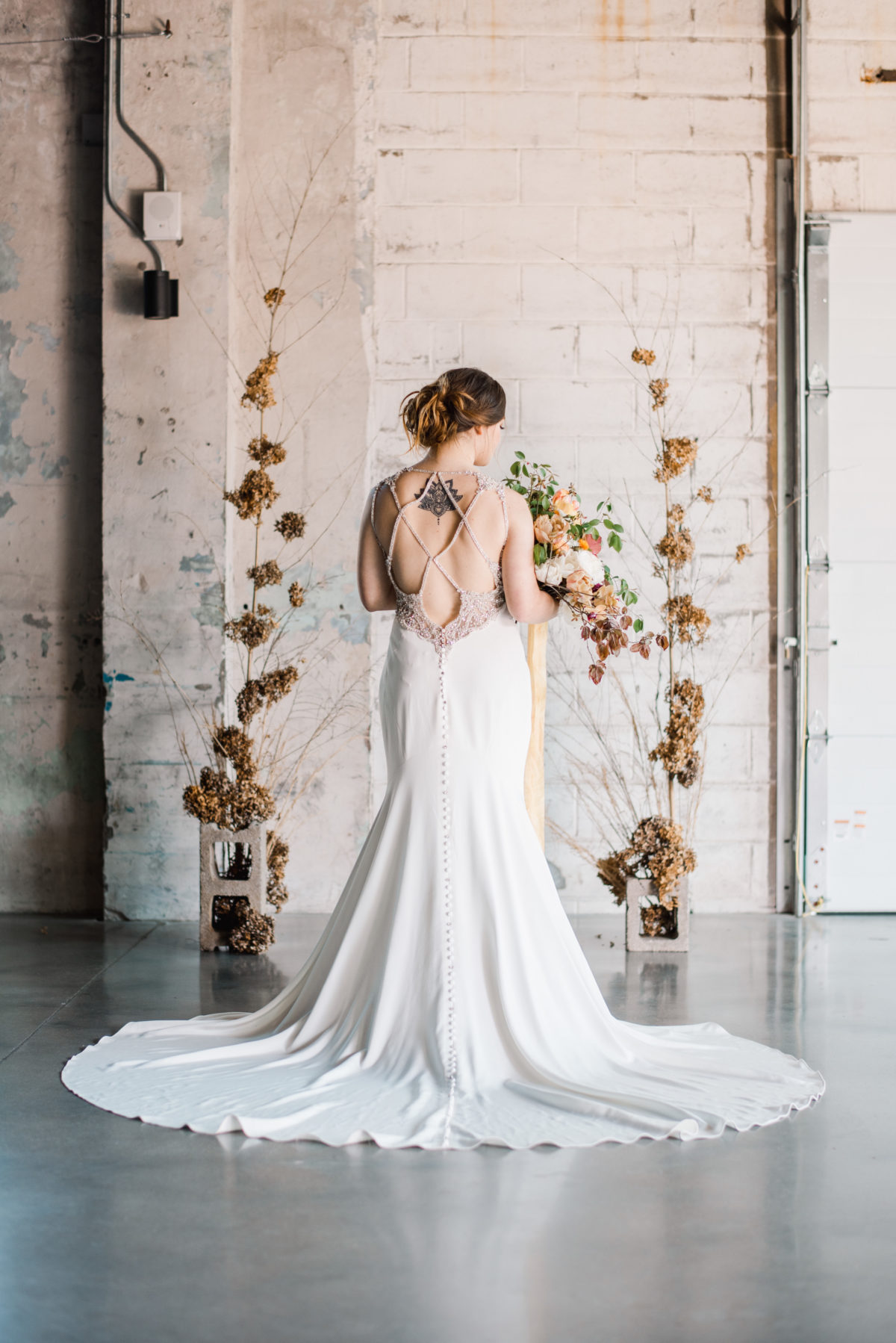 bride with open back dress at bentonville wedding venue