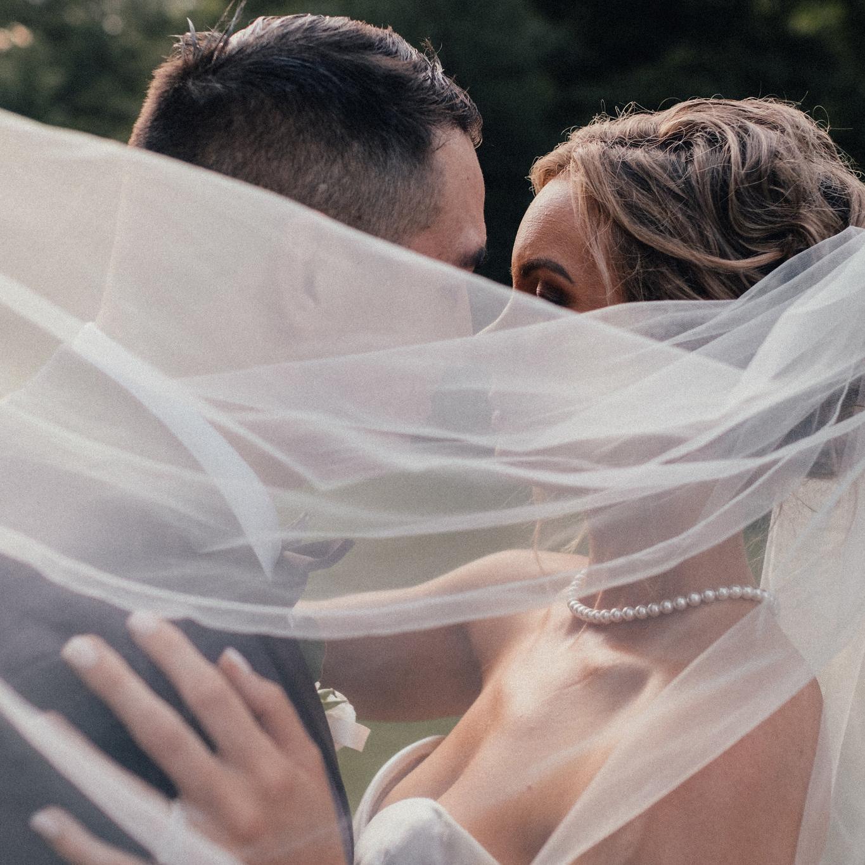 Bentonville wedding photo with bridal veil
