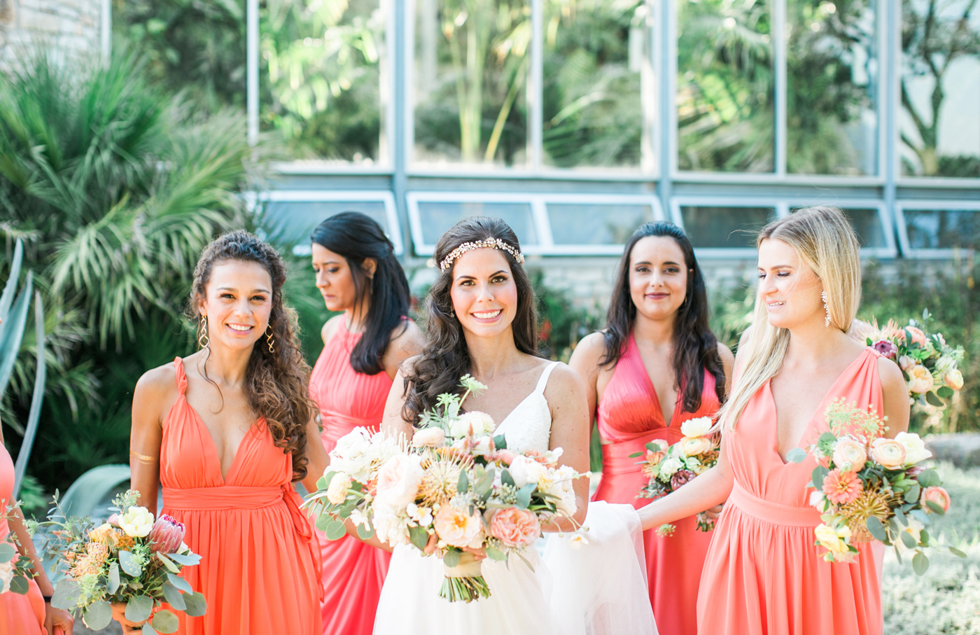 Bride and bridesmaids wearing colorful dresses in Northwest Arkansas