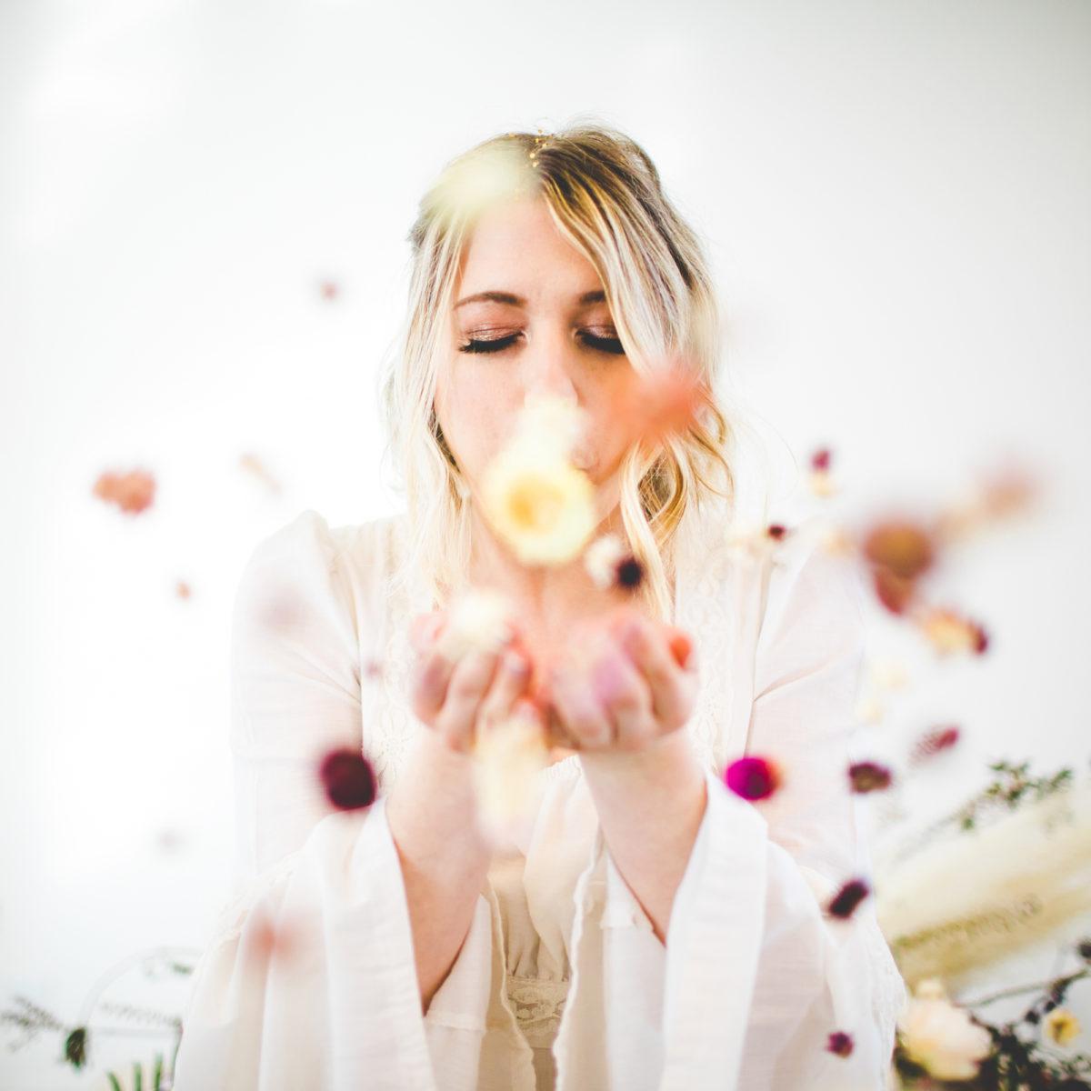 bride with flower confetti