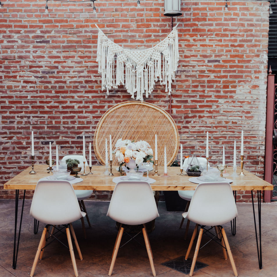 boho bridal party table with peacock chair in Fort Smith, AR