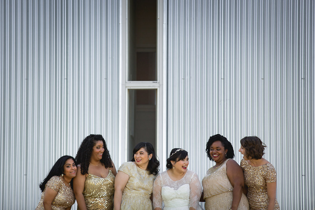 Bride with bridesmaids all in gold