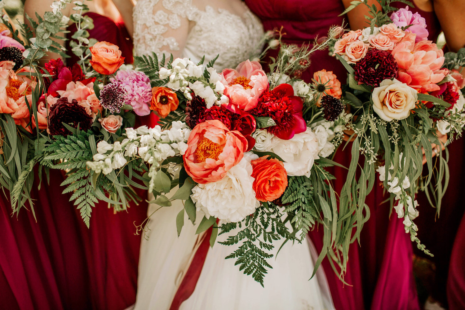 bright peach, red, and pink wedding bouquets