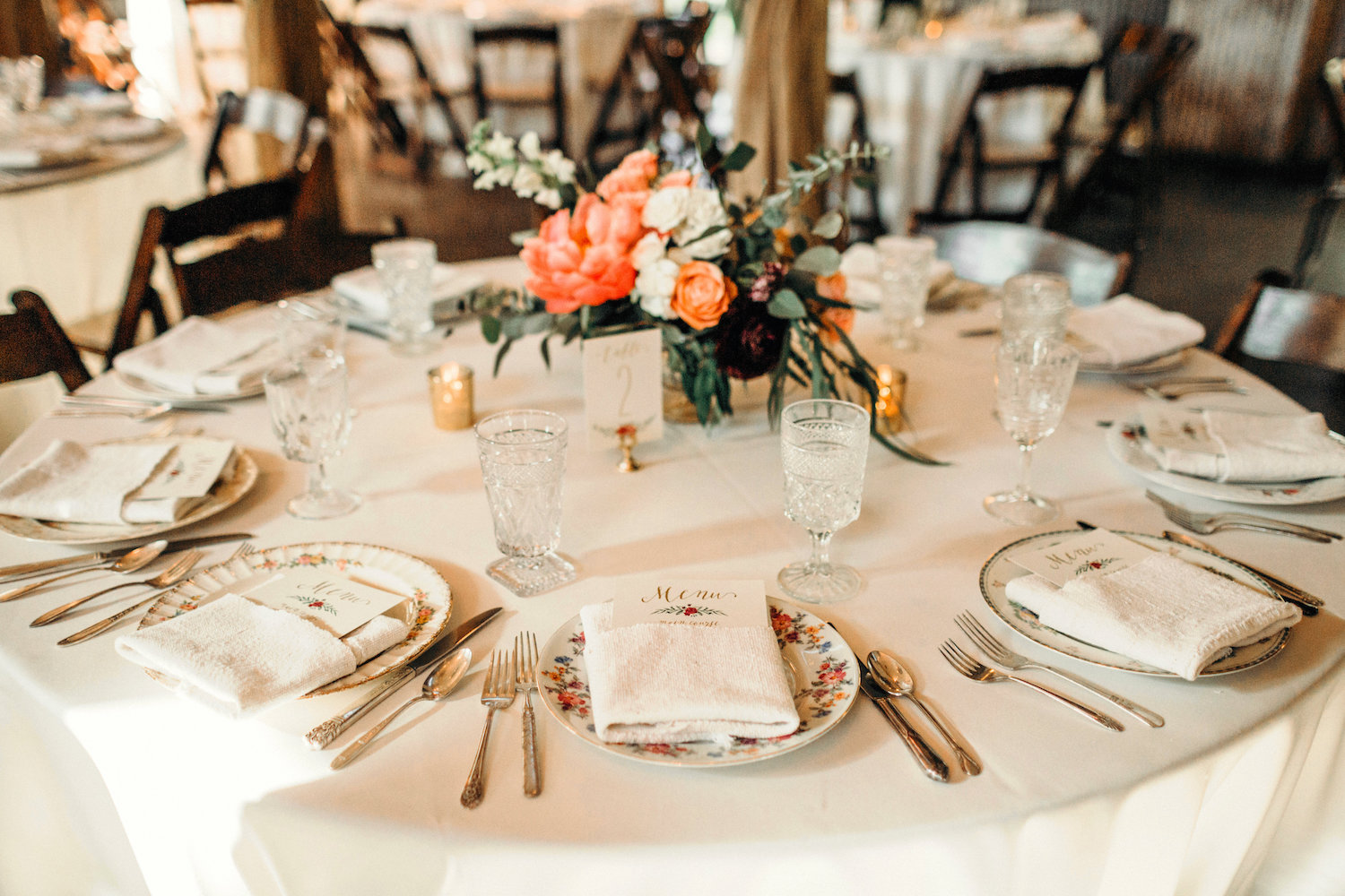 Rustic wedding table with vintage plates and glasses