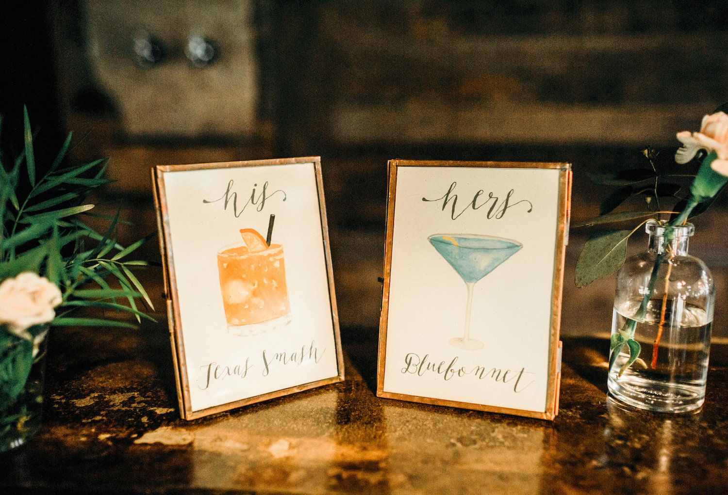 His and hers signs for special wedding cocktails