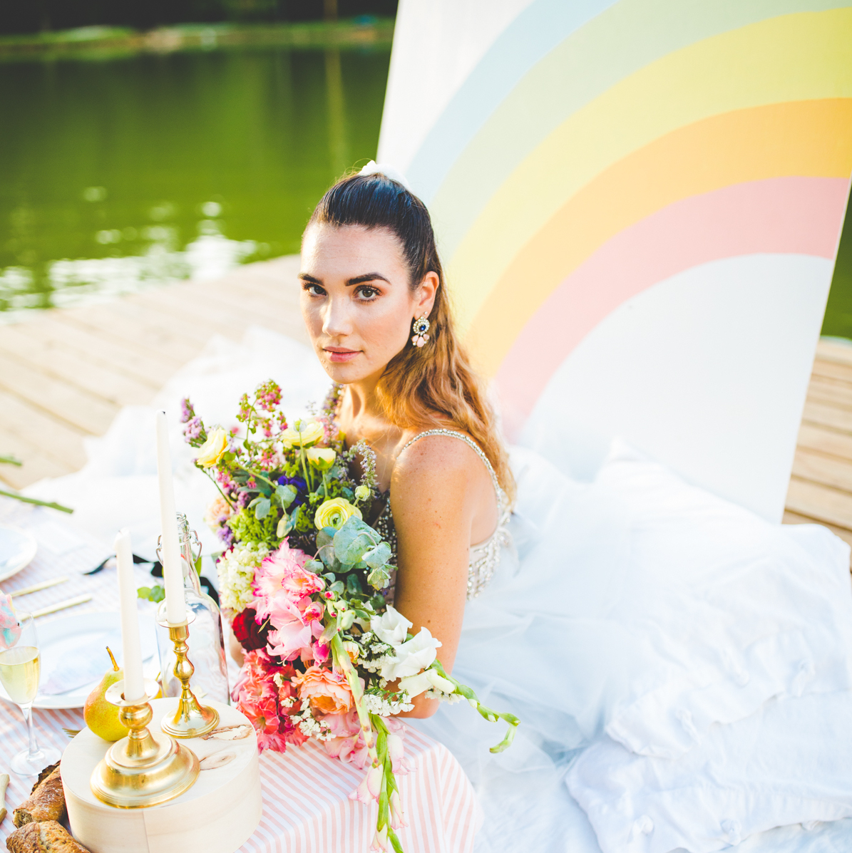 Bride with rainbow backdrop