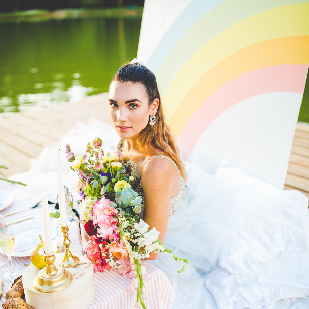 Bride with rainbow backdrop