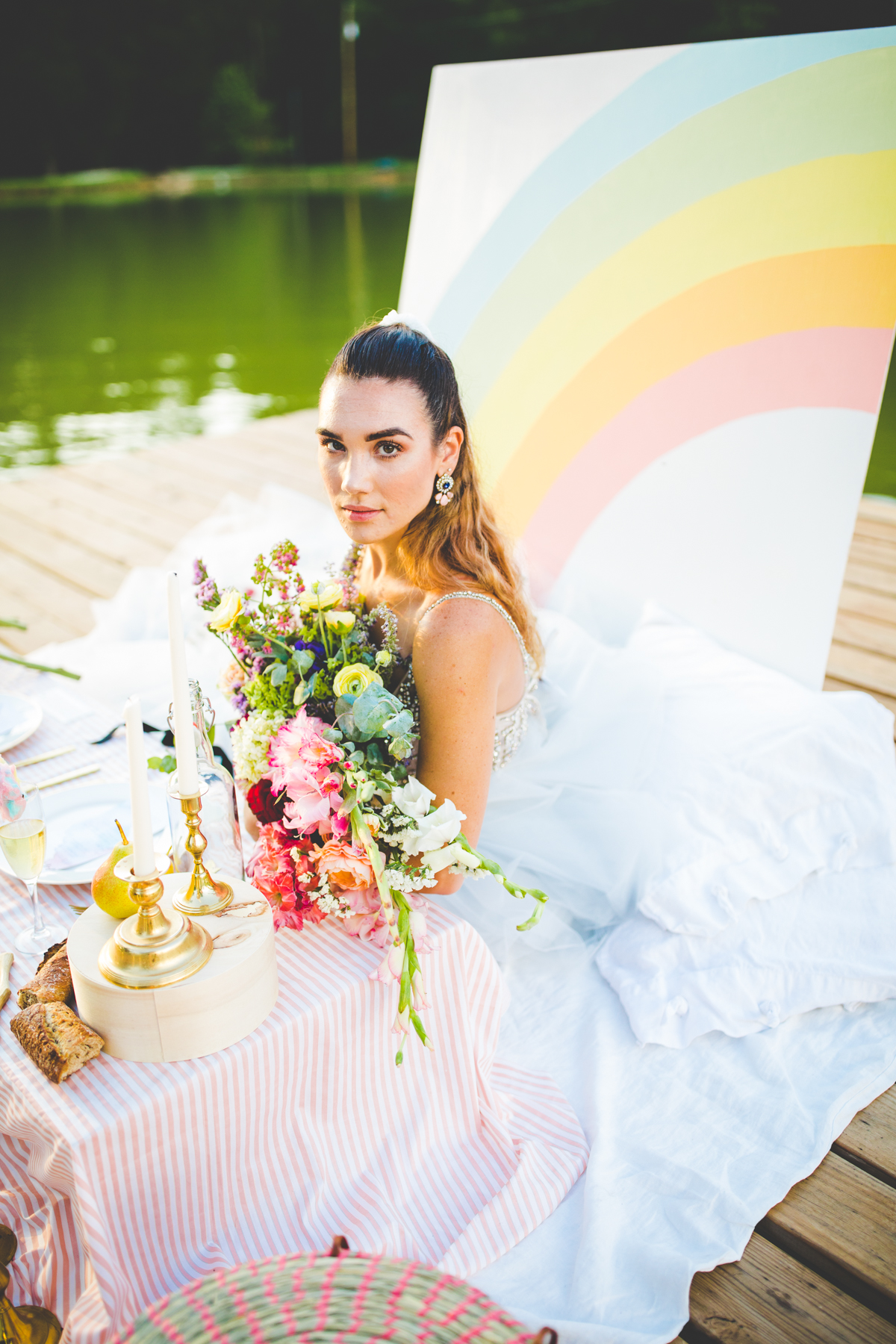 Bride in front of rainbow backdrop