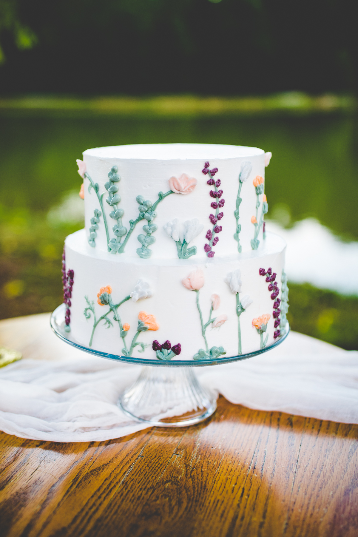 White wedding cake with embroidery flower decoration