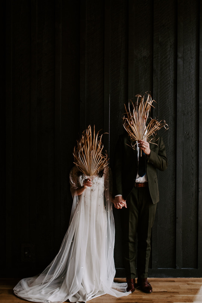 Dried palm wedding photo taken by Northwest Arkansas wedding photographer