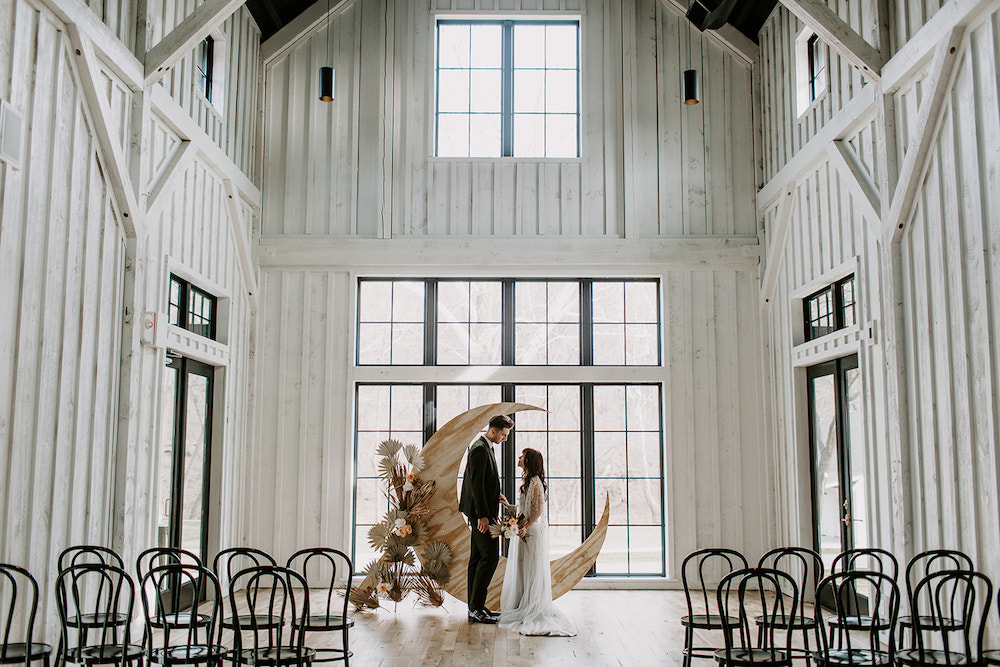 Bride and groom in front of moon planned by Northwest Arkansas wedding planner