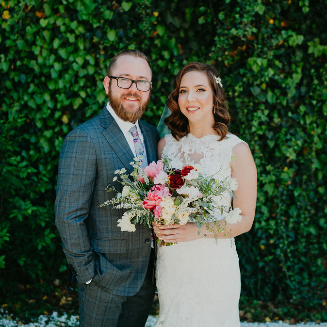 The Ravington Wedding photo in front of green wall