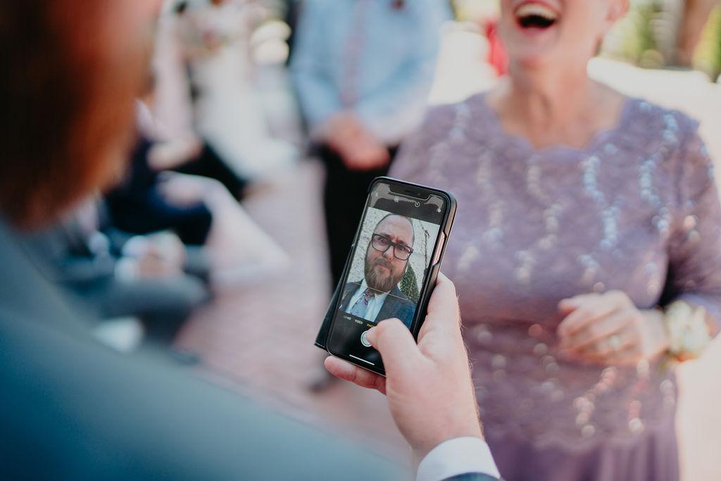 groom takes goofy selfie