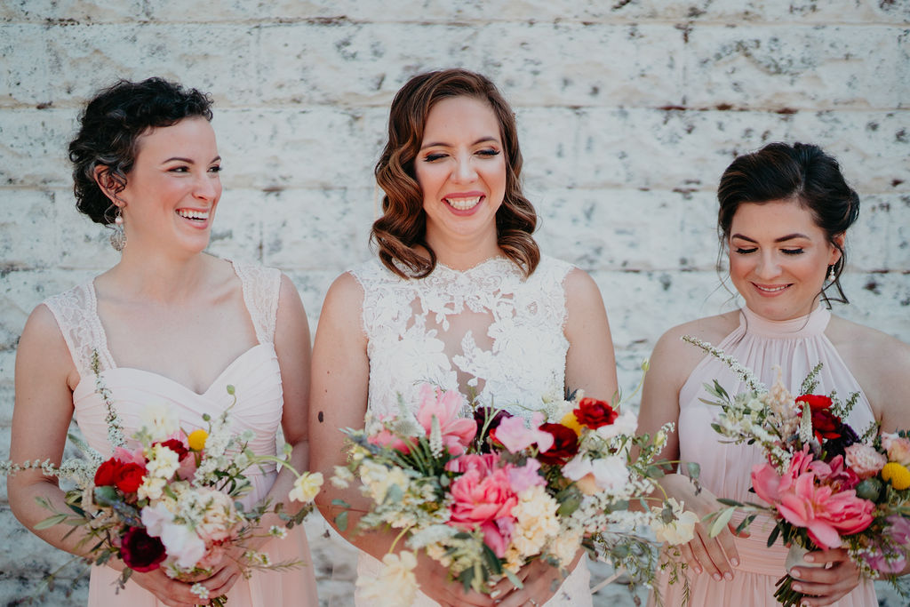 Bride and bridesmaids laugh at Centerton Arkansas wedding