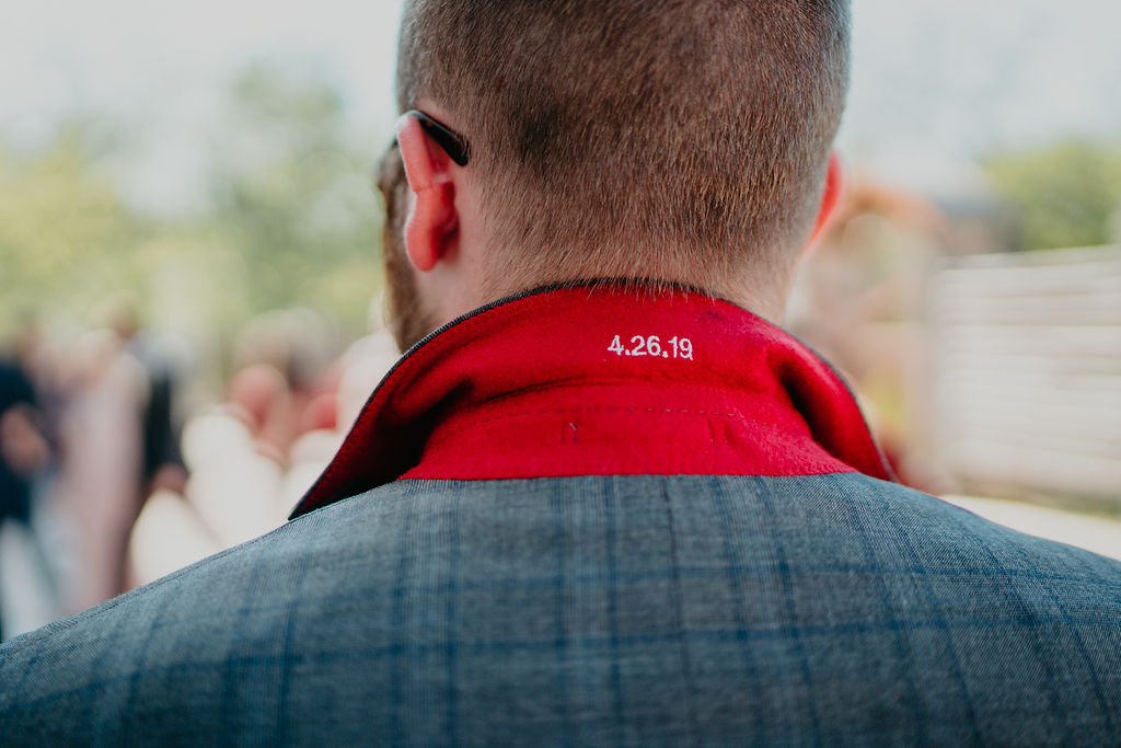Groom has wedding date embroidered on suit lapel