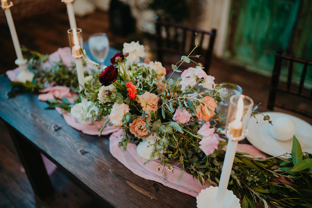 Wood table wedding with cheesecloth runner at The Ravington