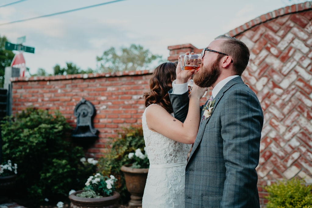 bride and groom have first drink as married couple