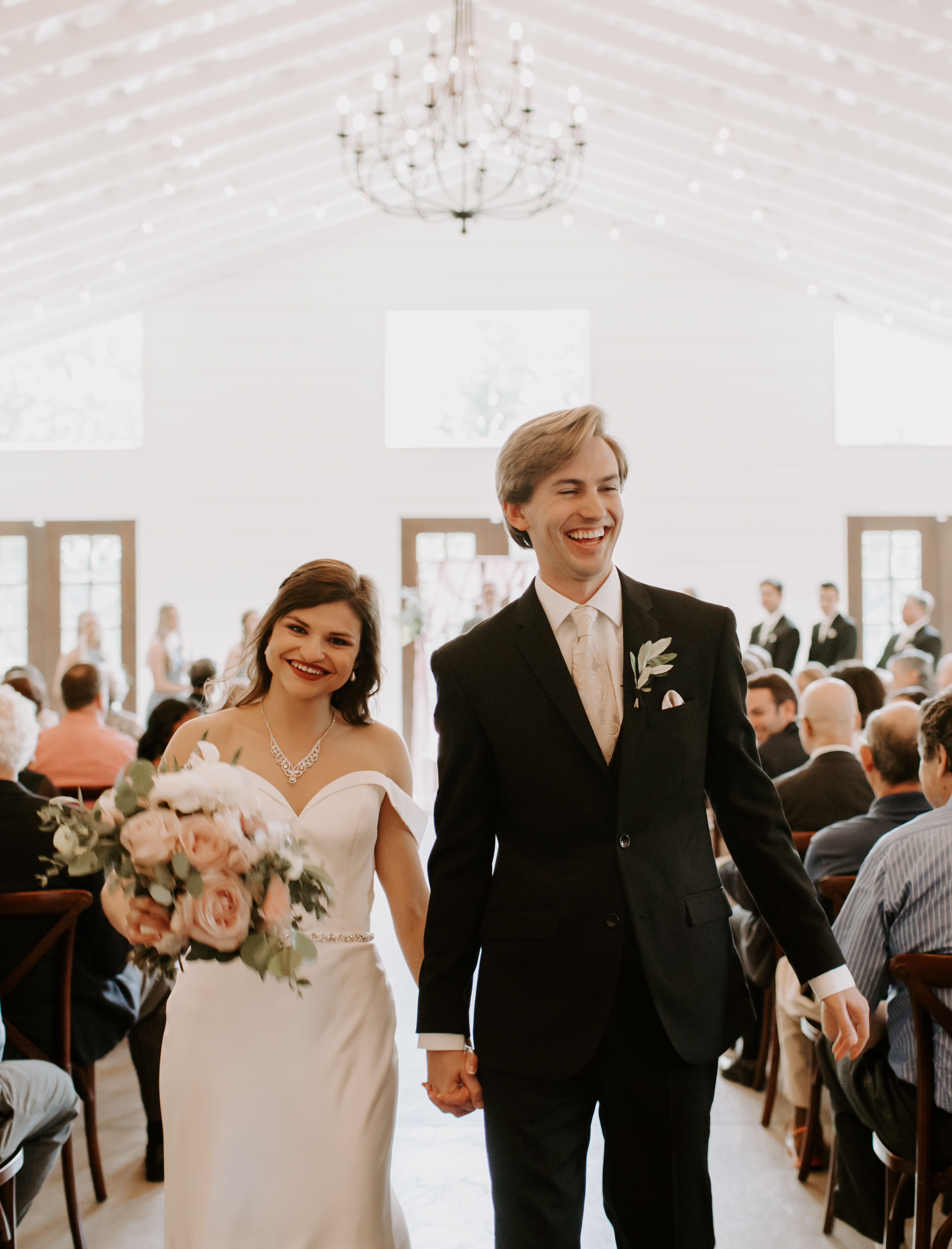 Bride and Groom walk down the aisle at The Loft at Stone Oak