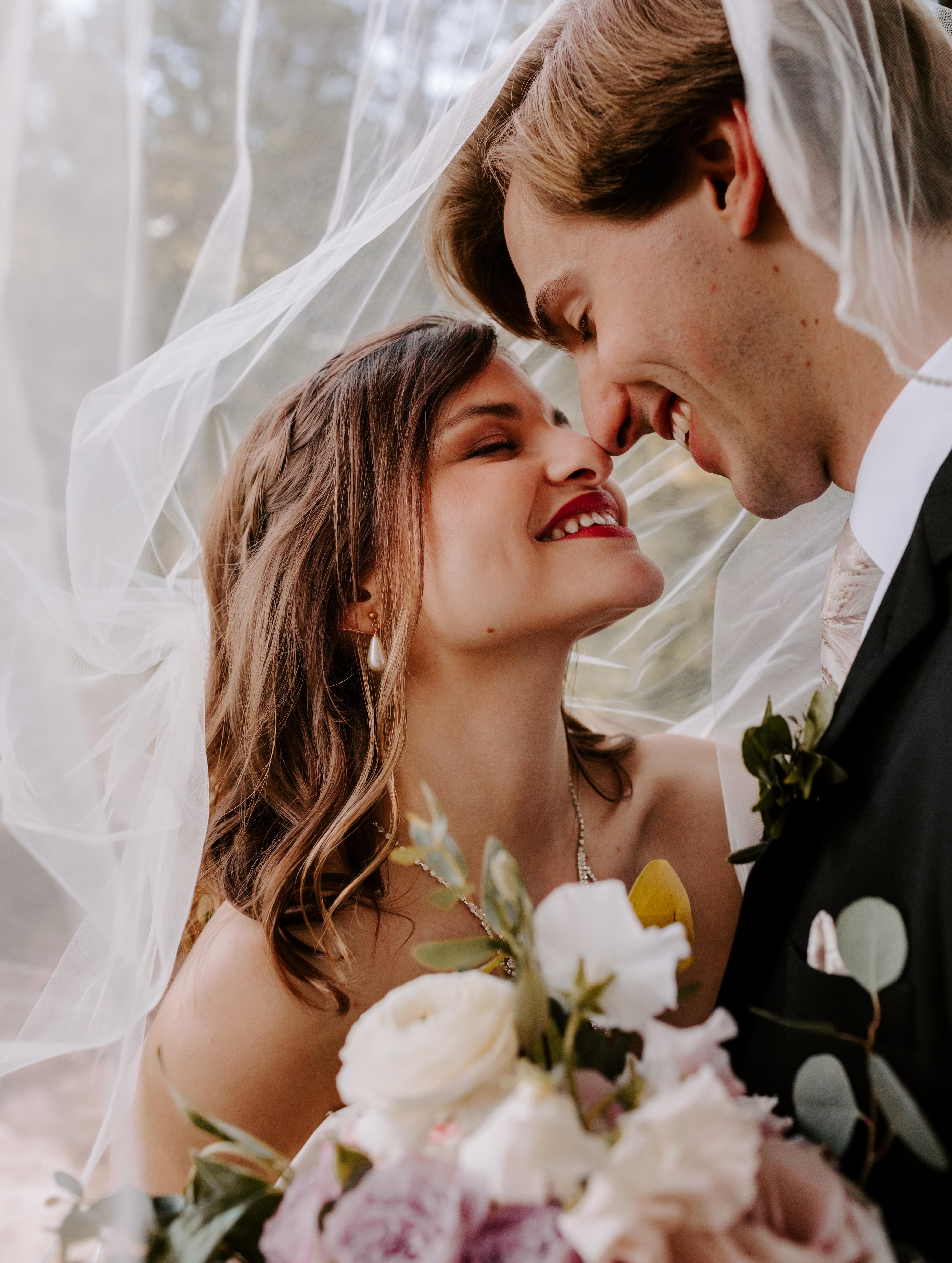 Fort Smith Arkansas bride and groom under veil