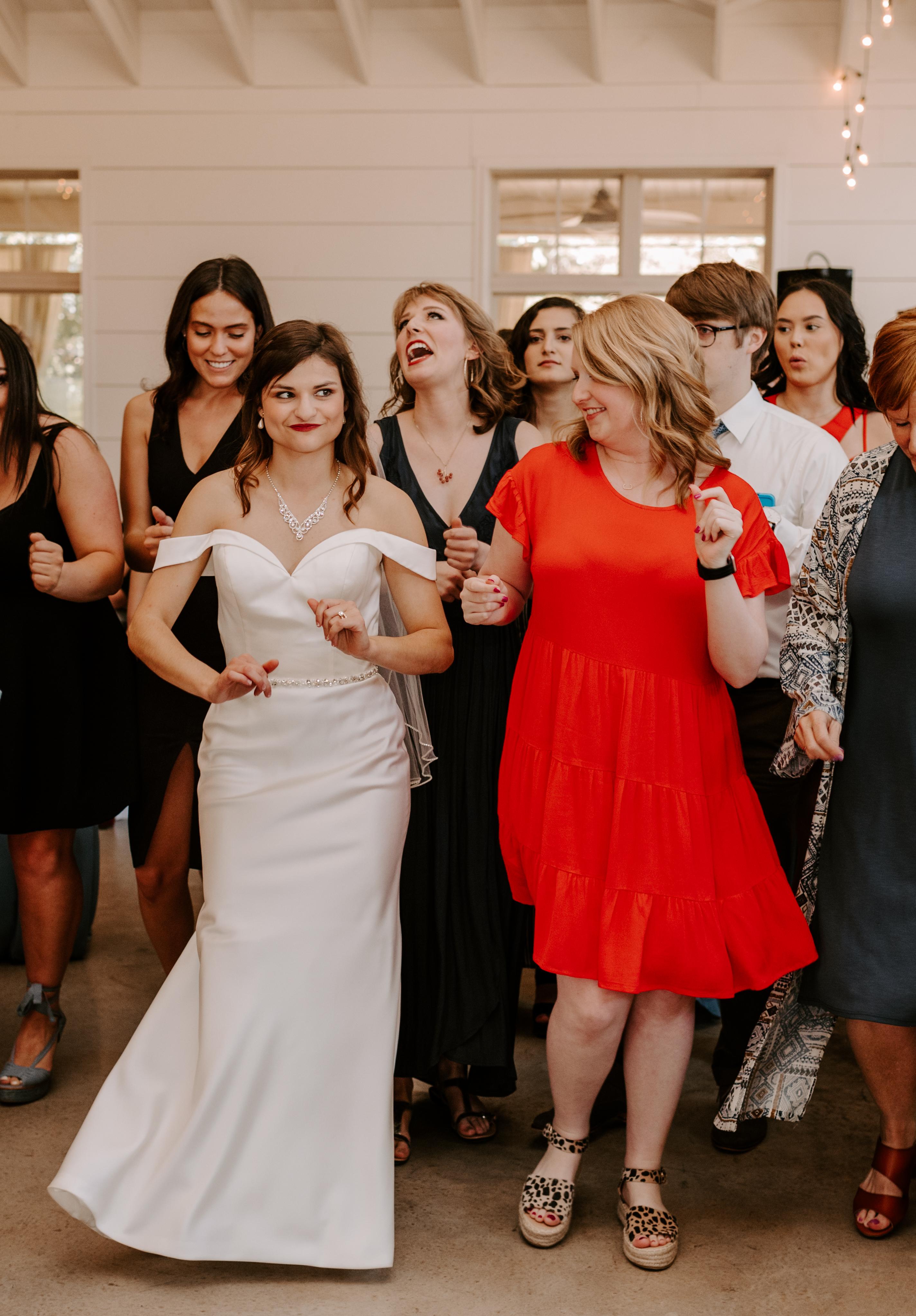 Bride doing line dance at wedding