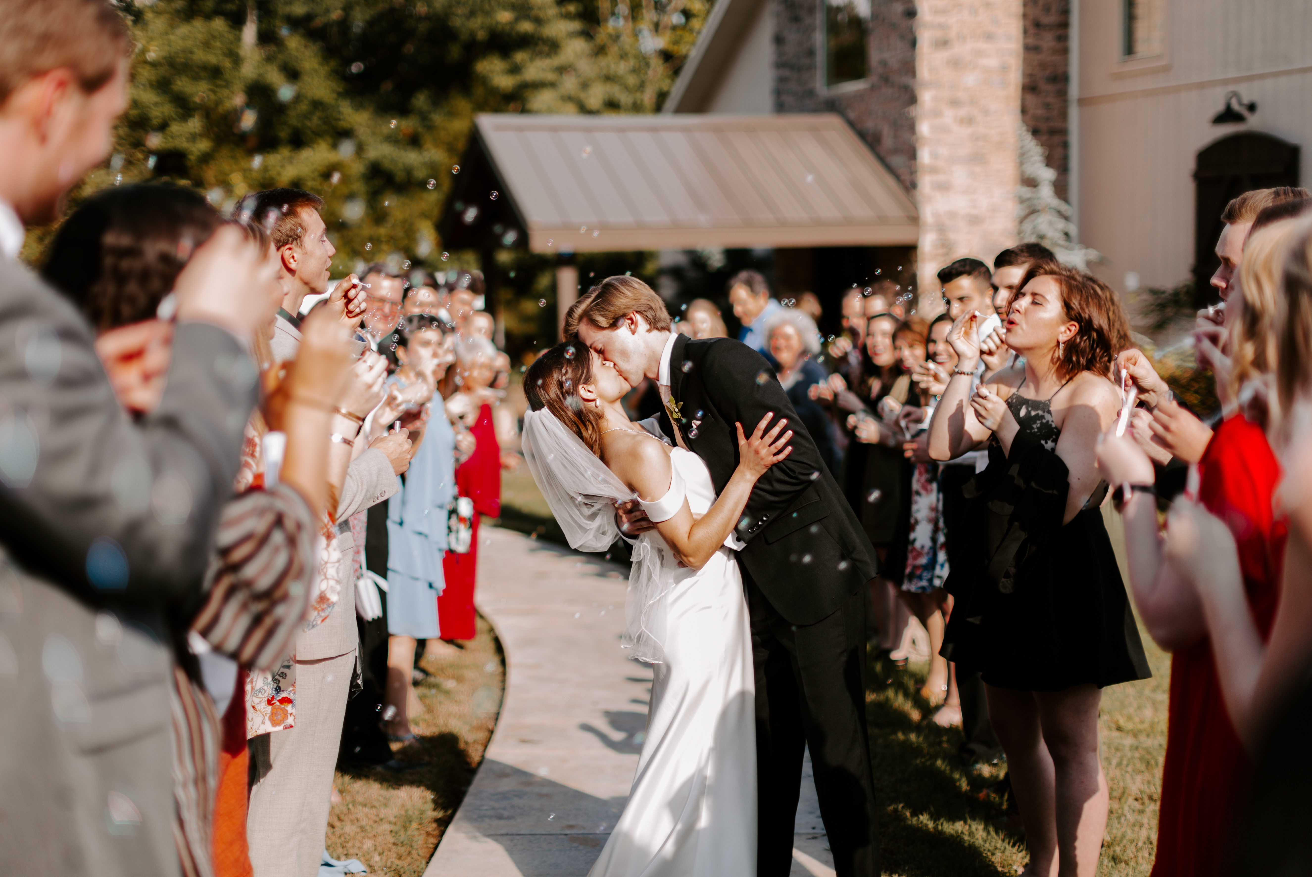 Bride and groom bubble exit after wedding