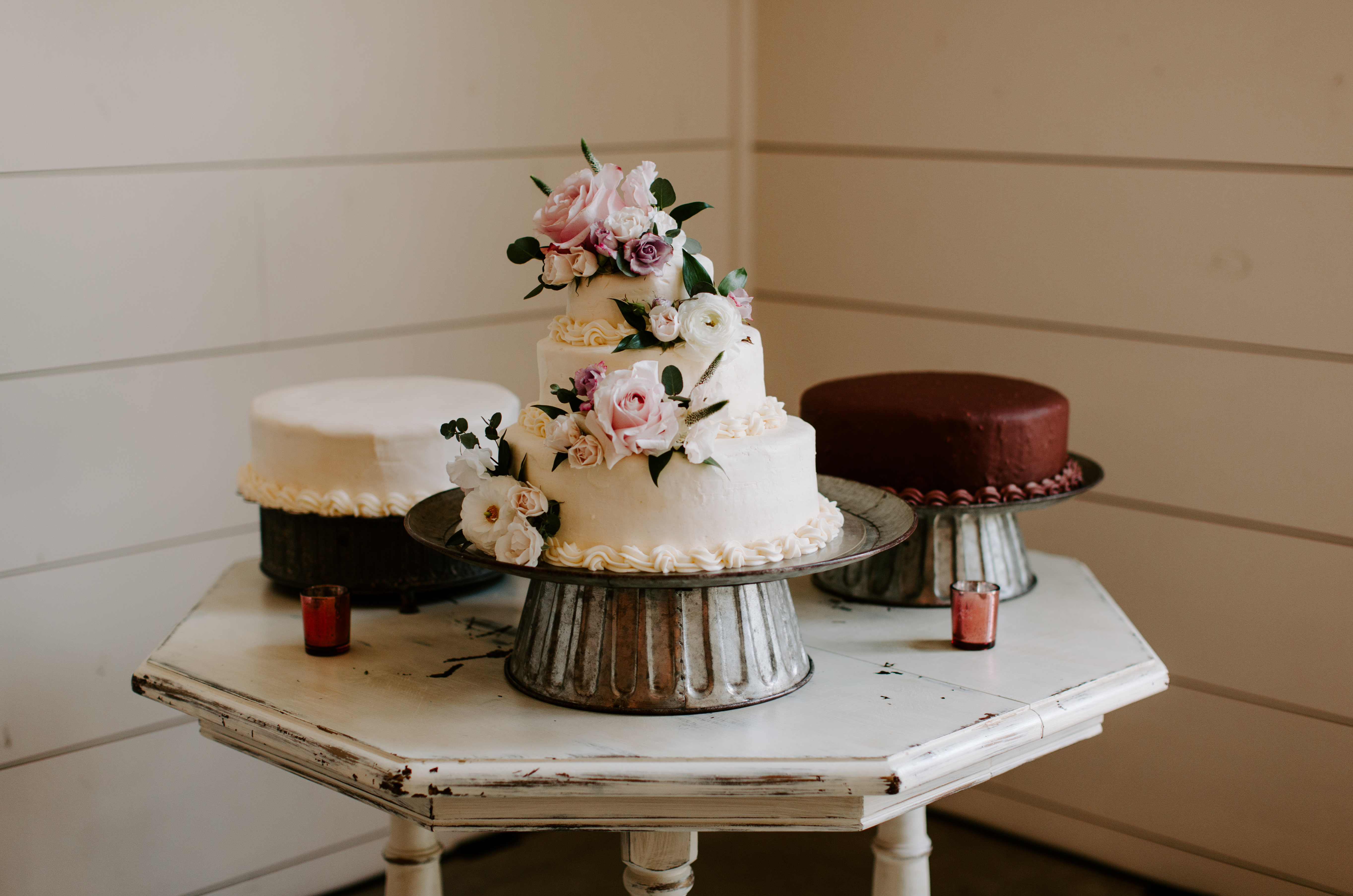 Cake table with vanilla and chocolate cakes at wedding