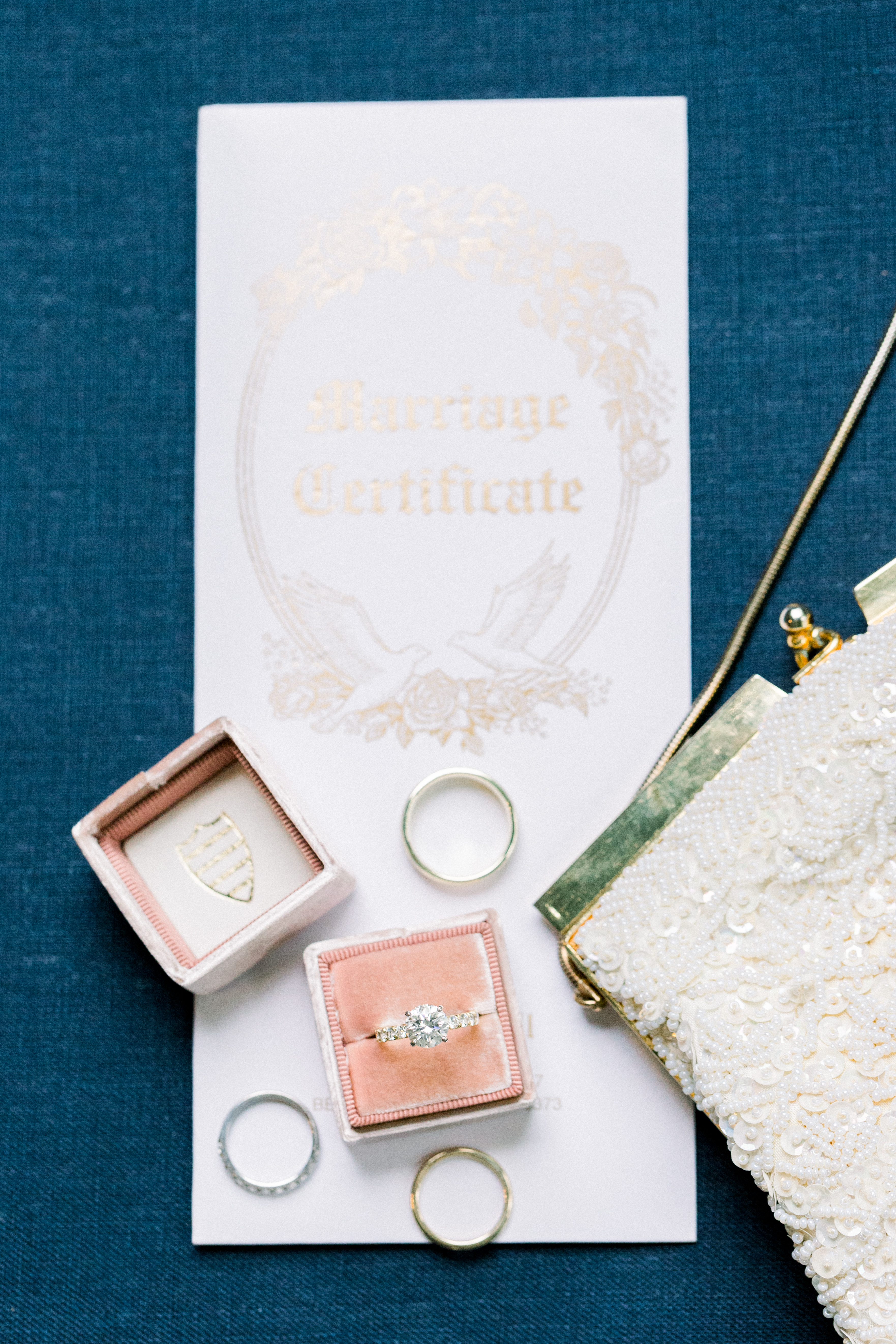 wedding ring in velvet pink box with marriage certificate