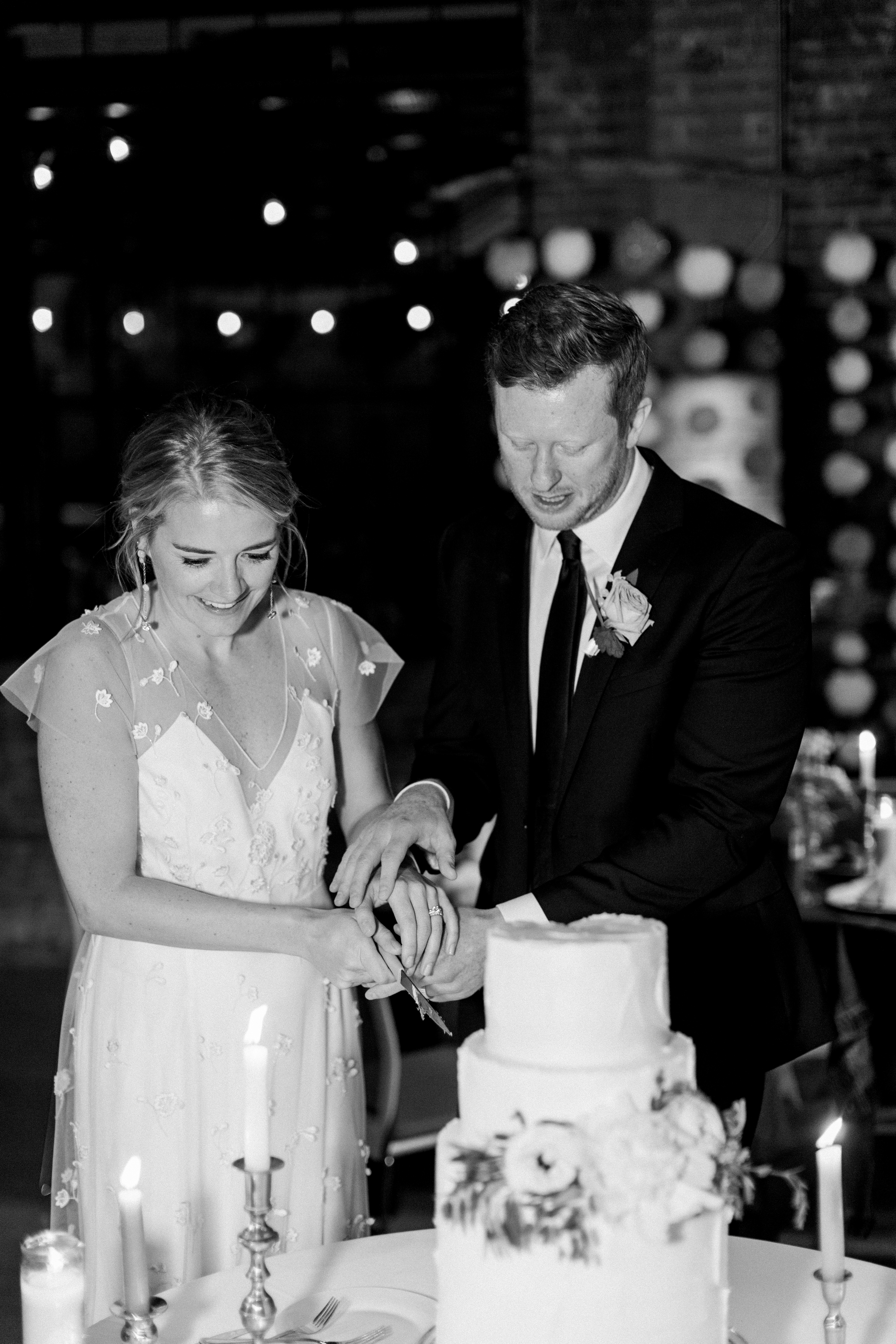Bride and groom cut cake at Record in Downtown Bentonville