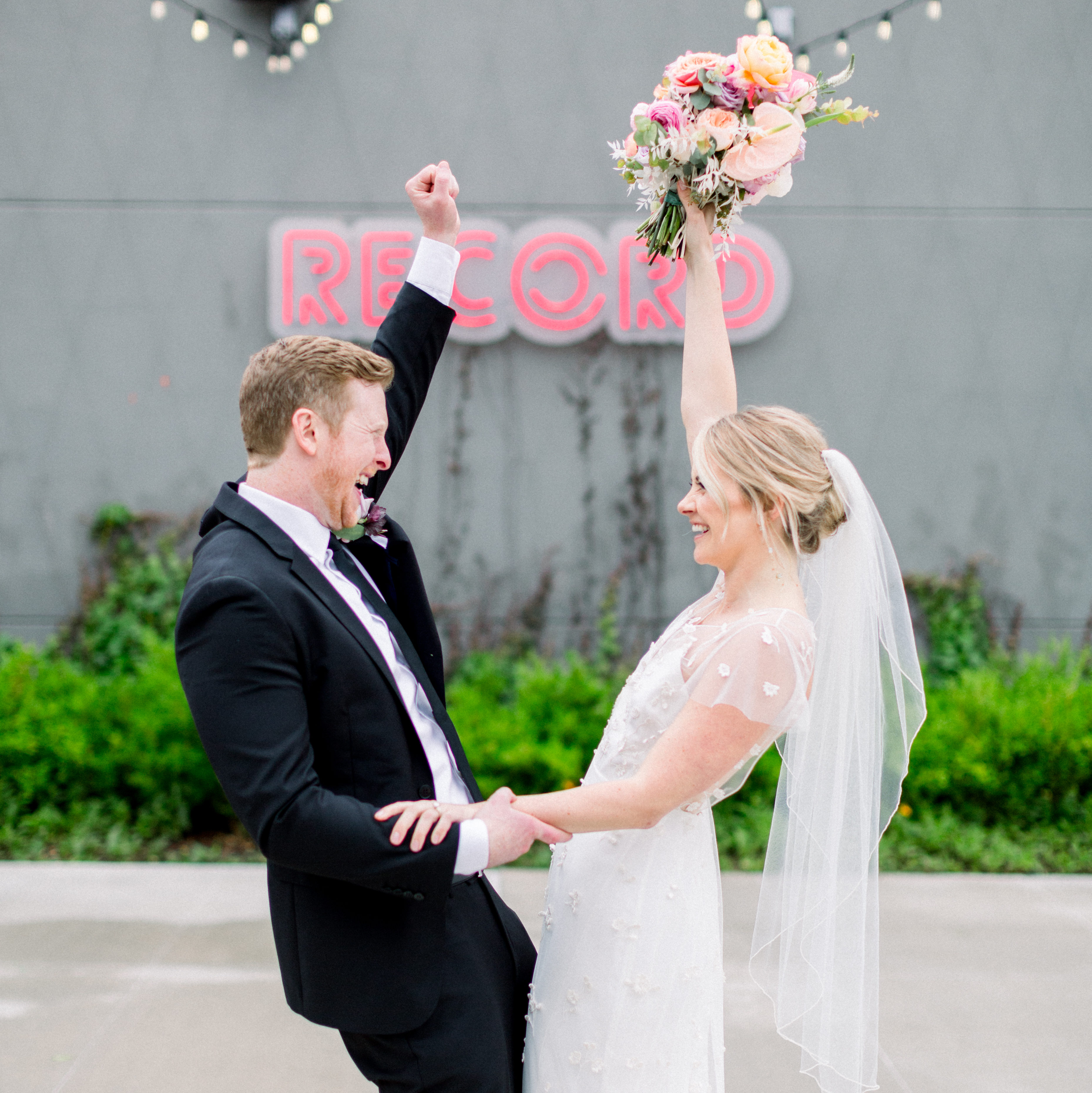 Record Downtown wedding photo with happy bride and groom