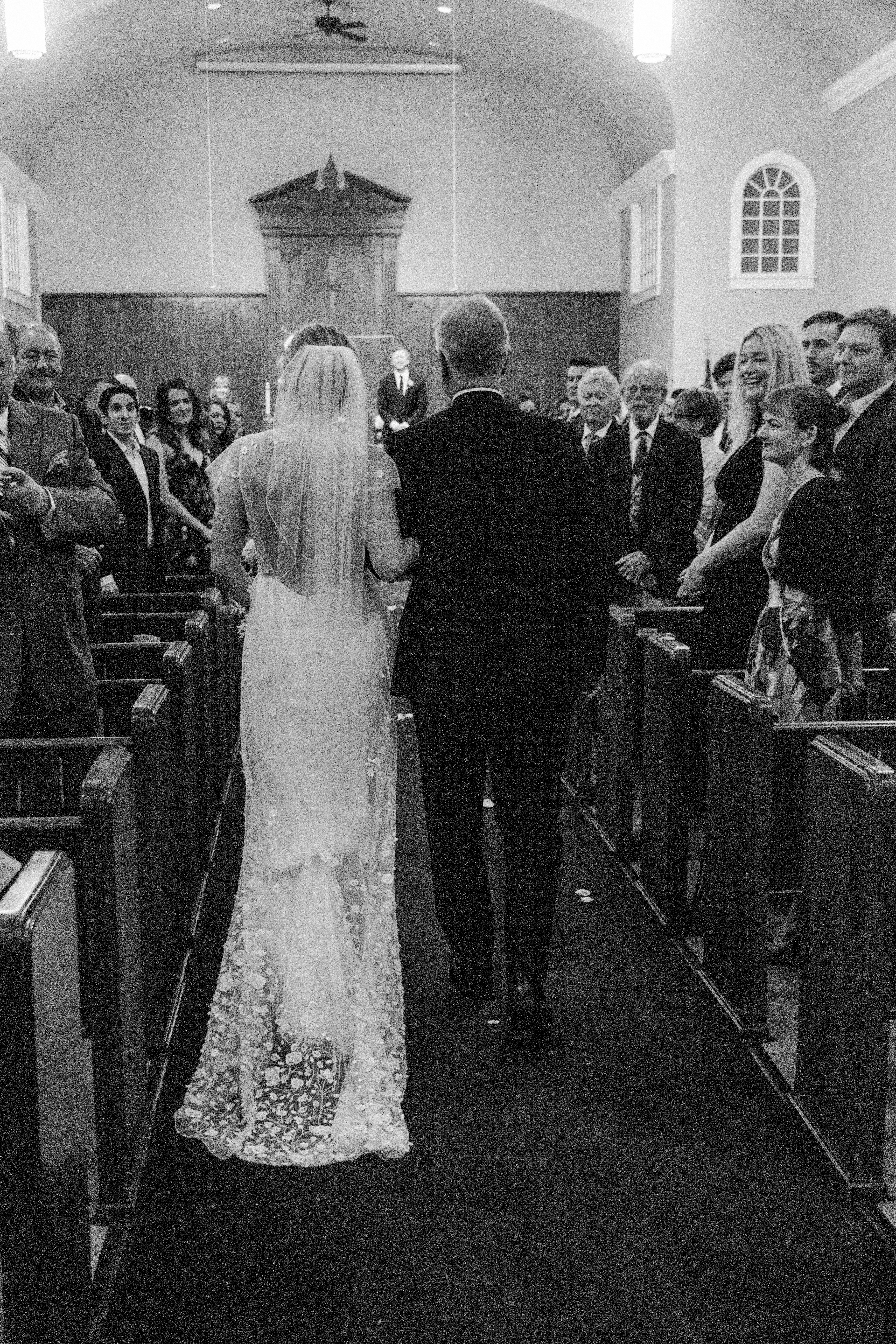 Bride and her father walk down the aisle at Bentonville First United Methodist Church wedding