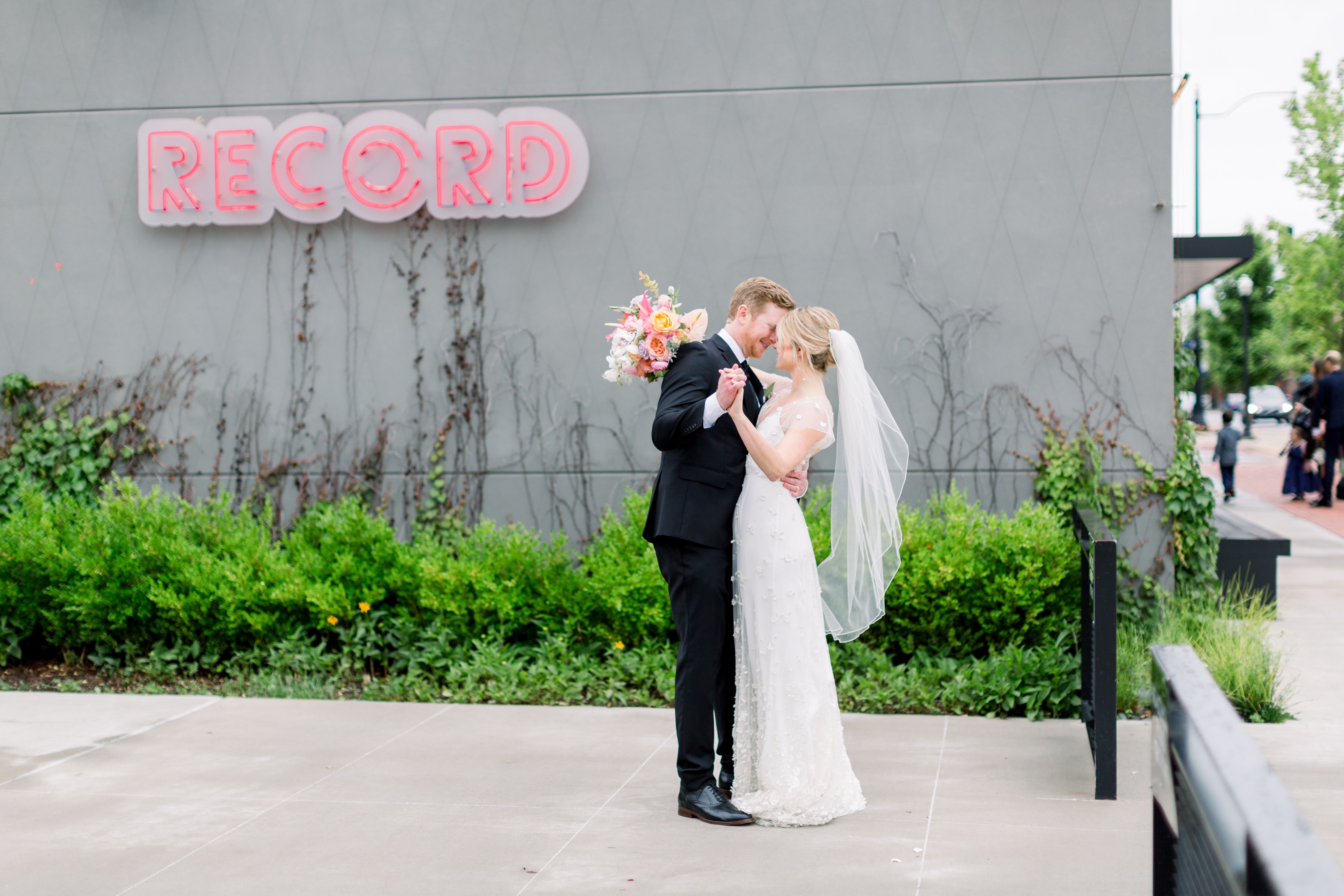 Bride and Groom in front of Record downtown Bentonville by Emma Farr Photography