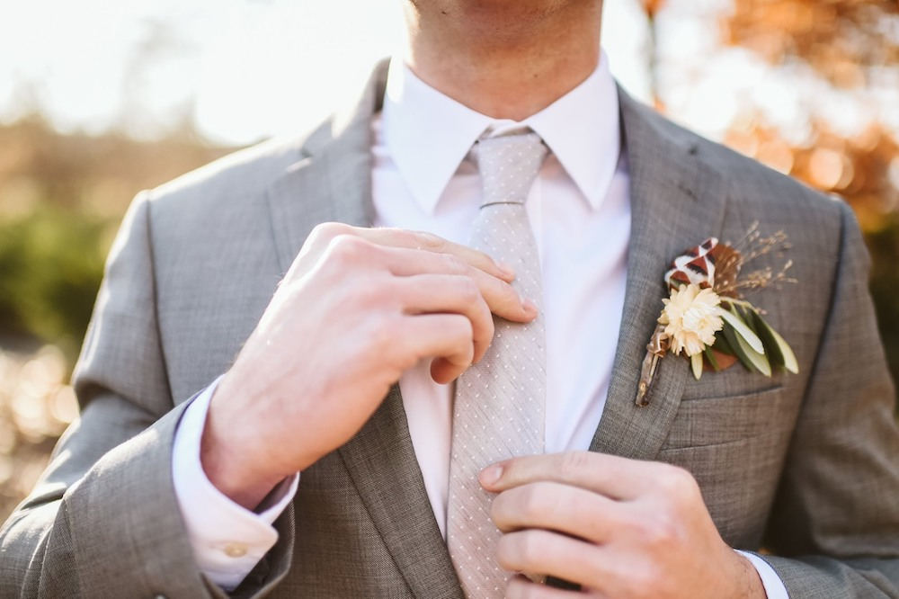 Groom at Sassafras Springs Vineyard & Winery Wedding with boutonniere from Meus Floral