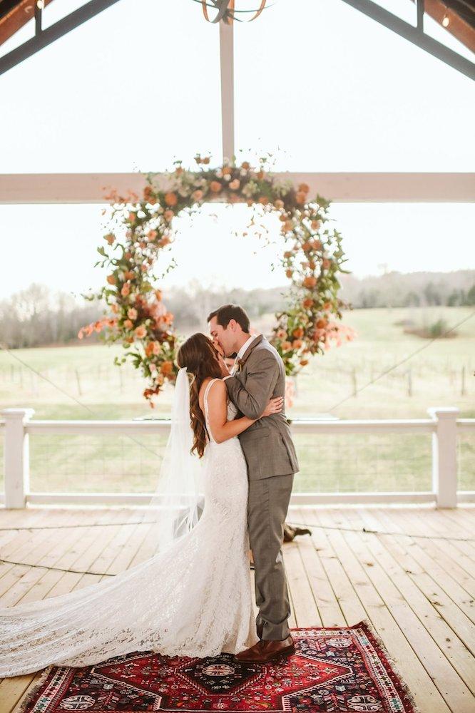 Sassafras Springs Vineyard & Winery Wedding  kiss