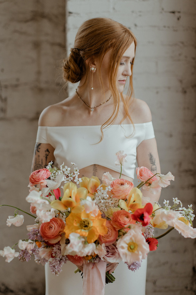 Bride holding bouquet from Fleurish
