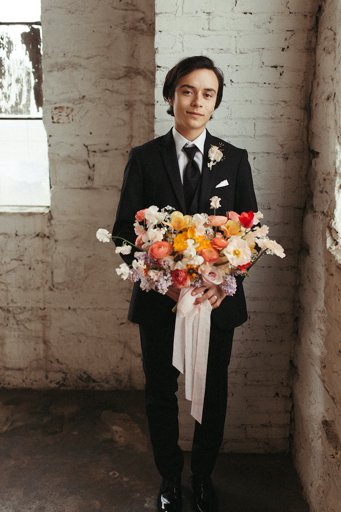 Groom holding bouquet from Fleurish
