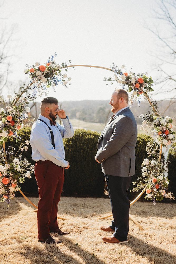 LGBT couple tears up in front of wedding arch in Fayetteville Arkansas