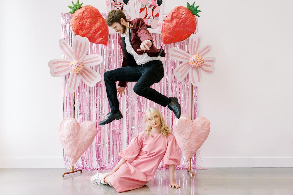 groom jumping over bride in short pink dress