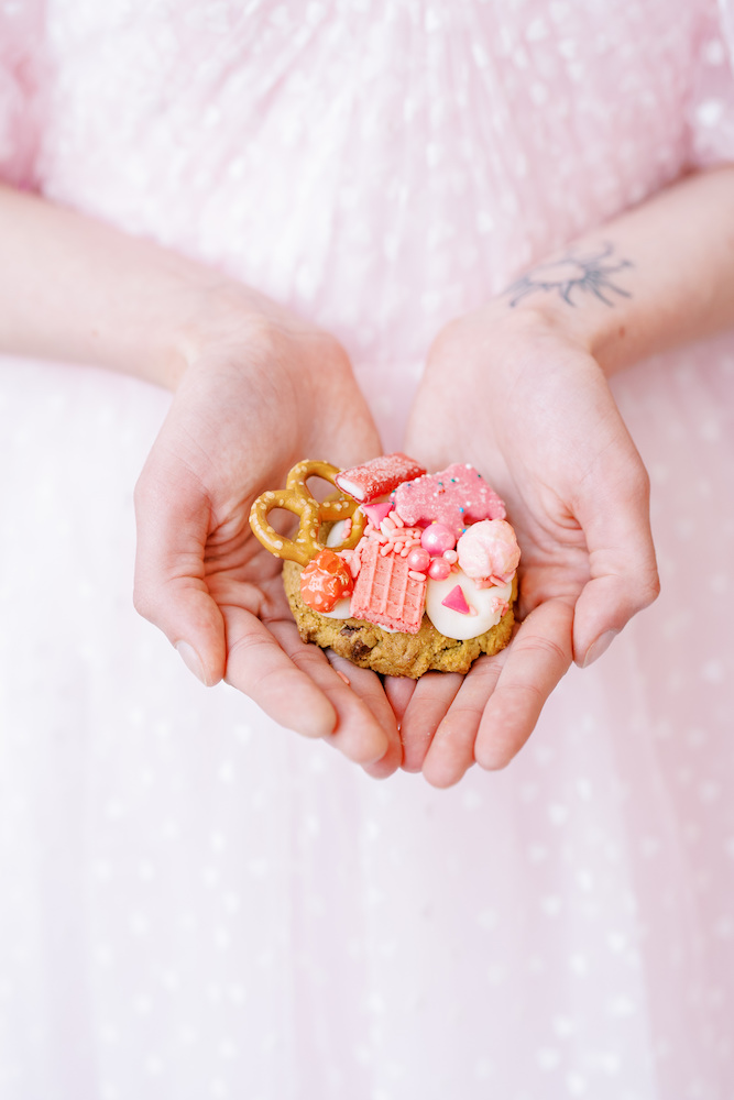 kitschy pink cookie in front of pink wedding dress